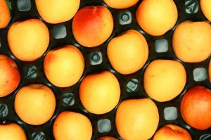 Apricots in a plastic carton.